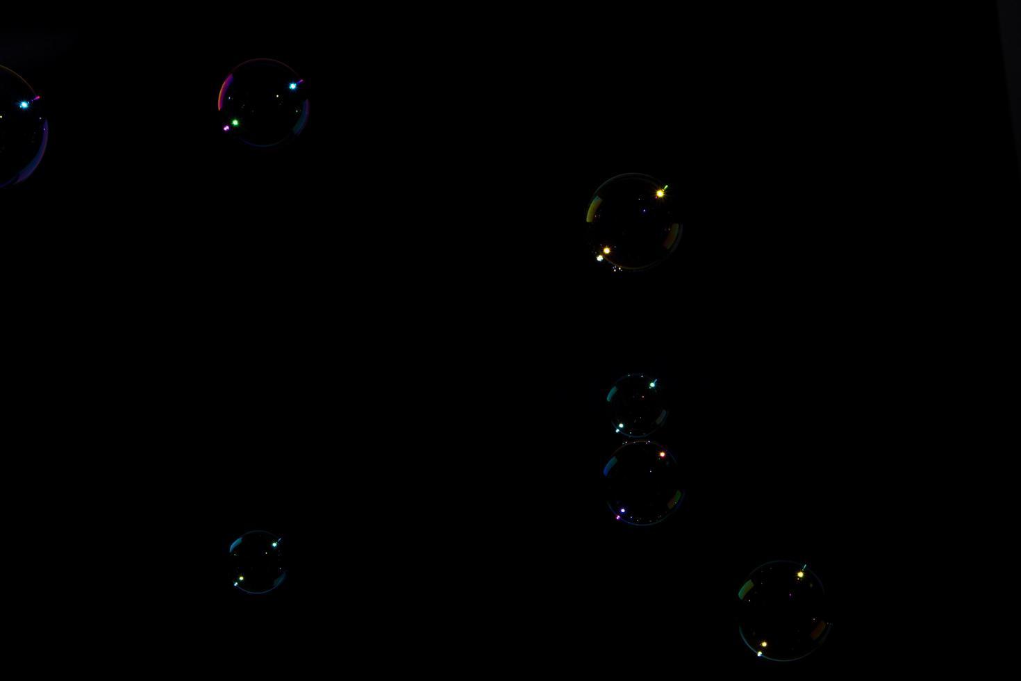 Bubbles on black background photo