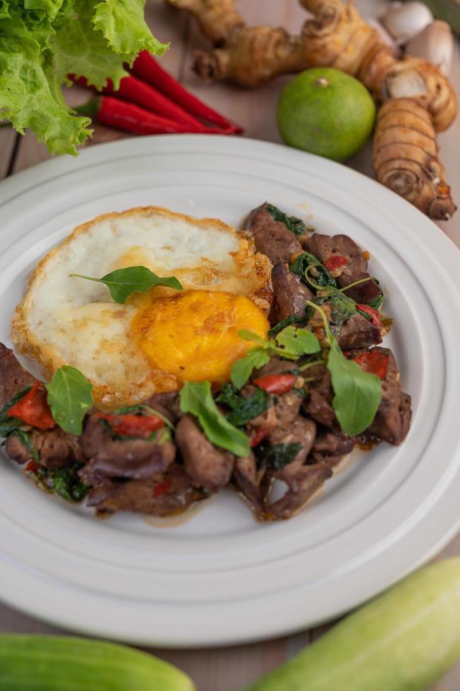 Stir fried basil liver with fried egg photo