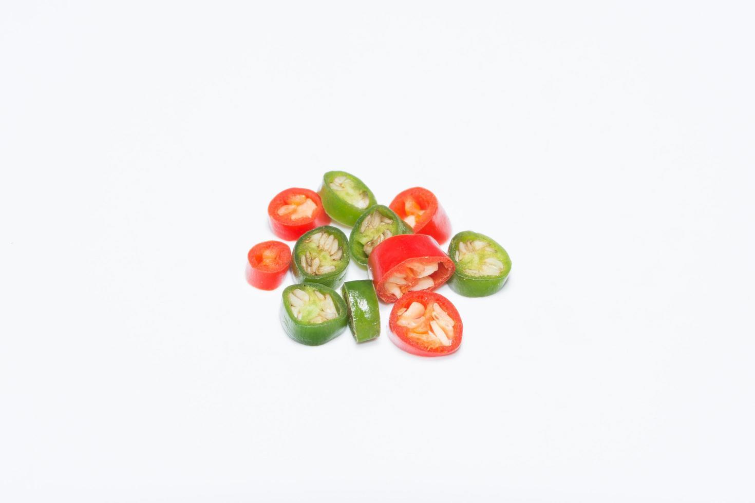 Chili, sliced on white background photo
