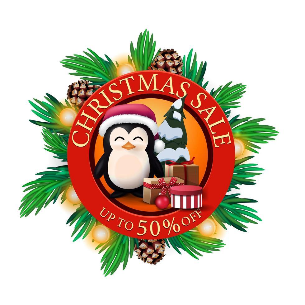 Venta de Navidad, hasta 50 de descuento, banner de descuento redondo rojo con ramas de árboles de Navidad, conos, bombillas y pingüino con gorro de Papá Noel con regalos. vector