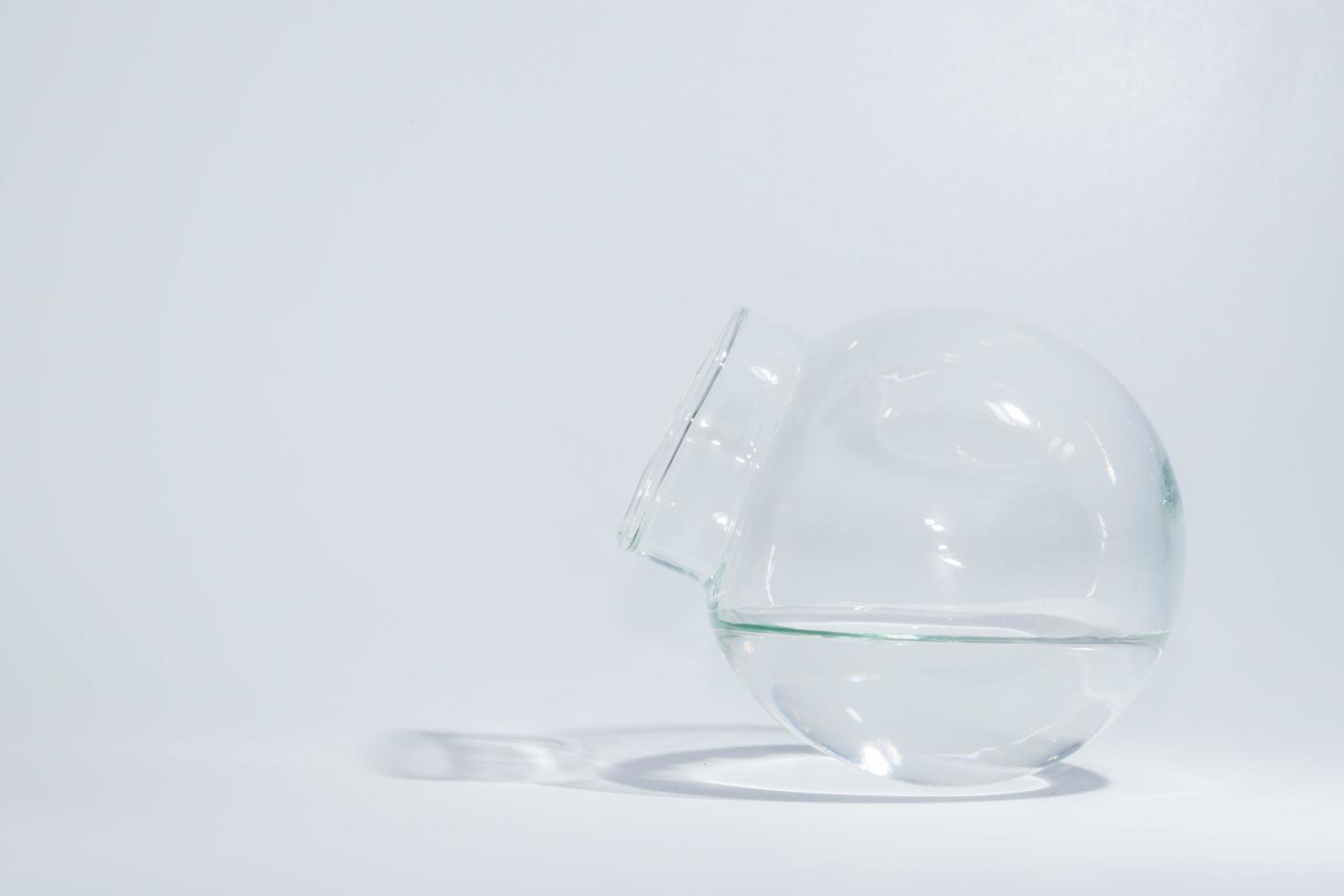 Globular jar filled with water inside photo