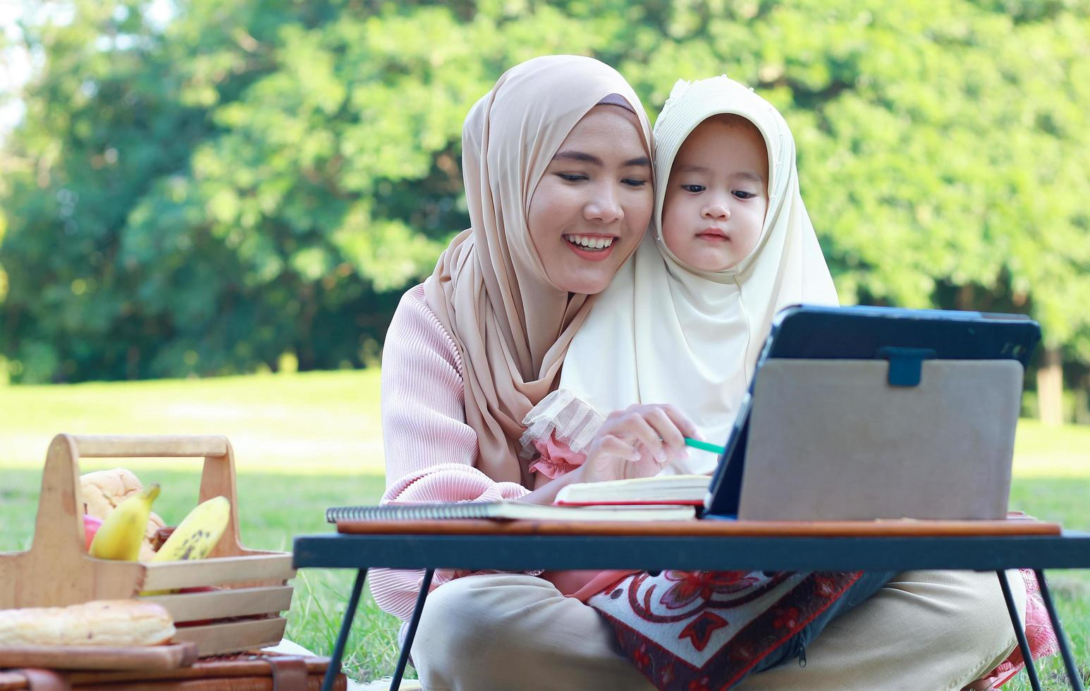 Muslim mothers and daughters enjoy their holidays in the park. Love and bond between mother and child photo