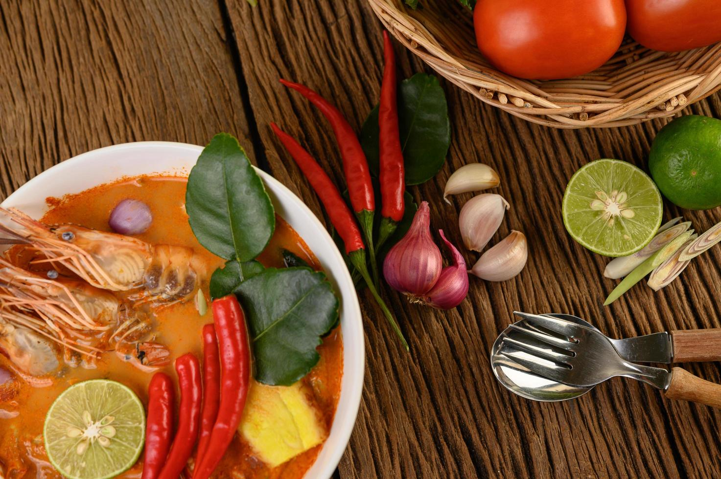 Hot and spicy tom yum kung Thai soup photo