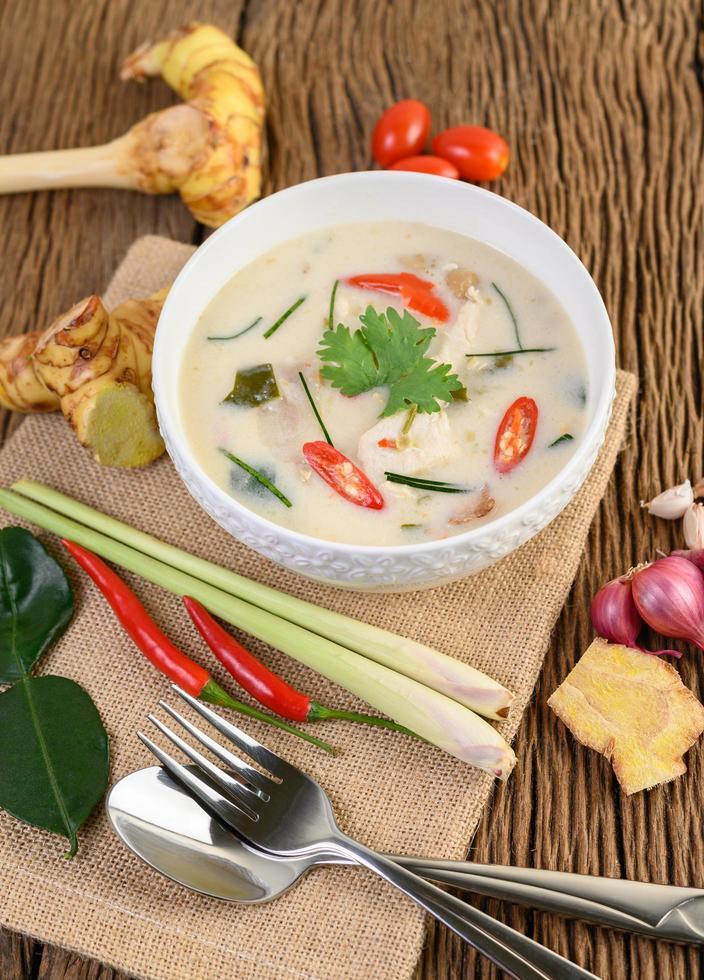 Tom Kha Kai, Thai coconut soup on wooden kitchen board photo