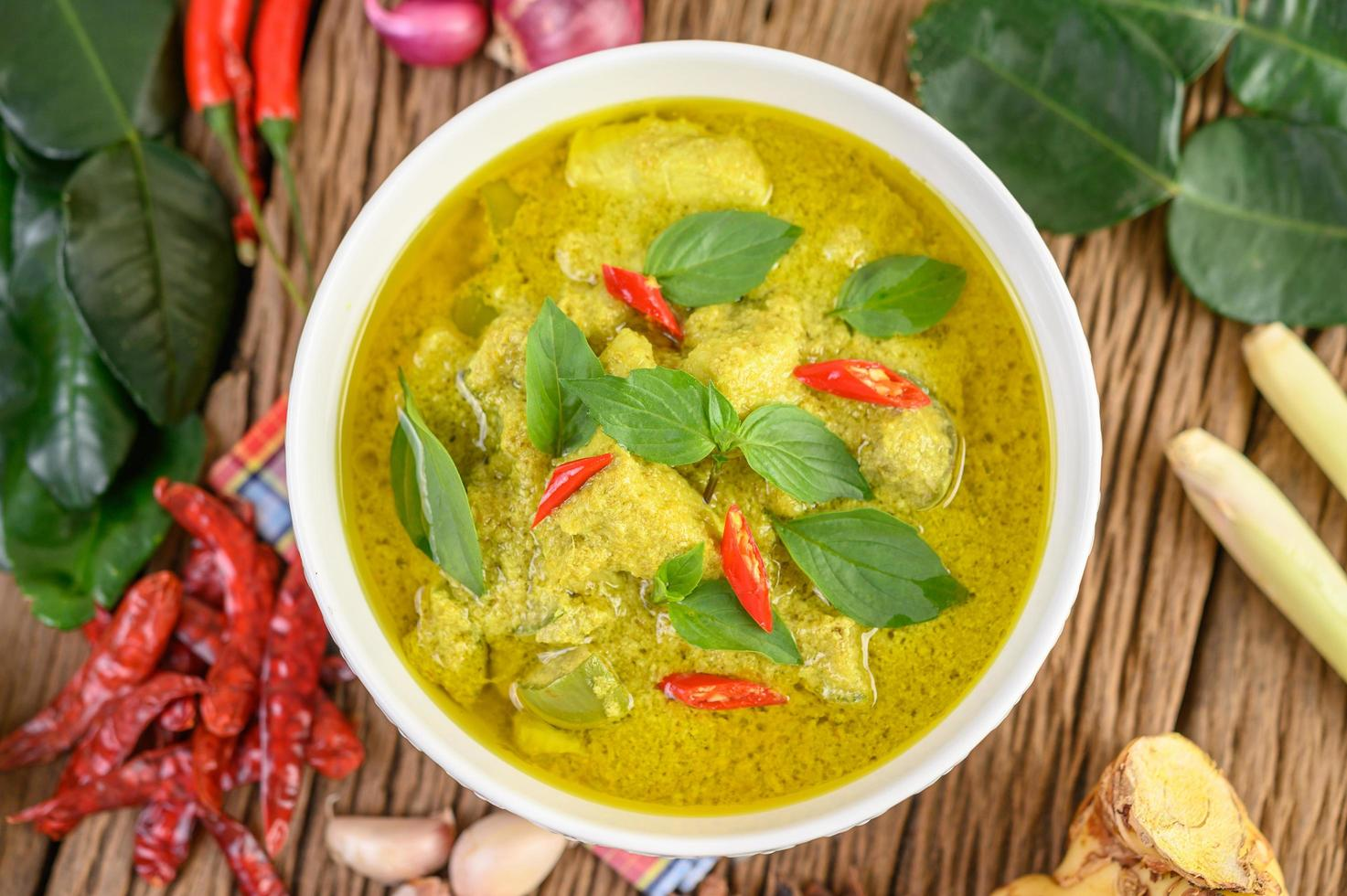 Green curry with limes, red onion, lemon grass, garlic and kaffir leaves photo