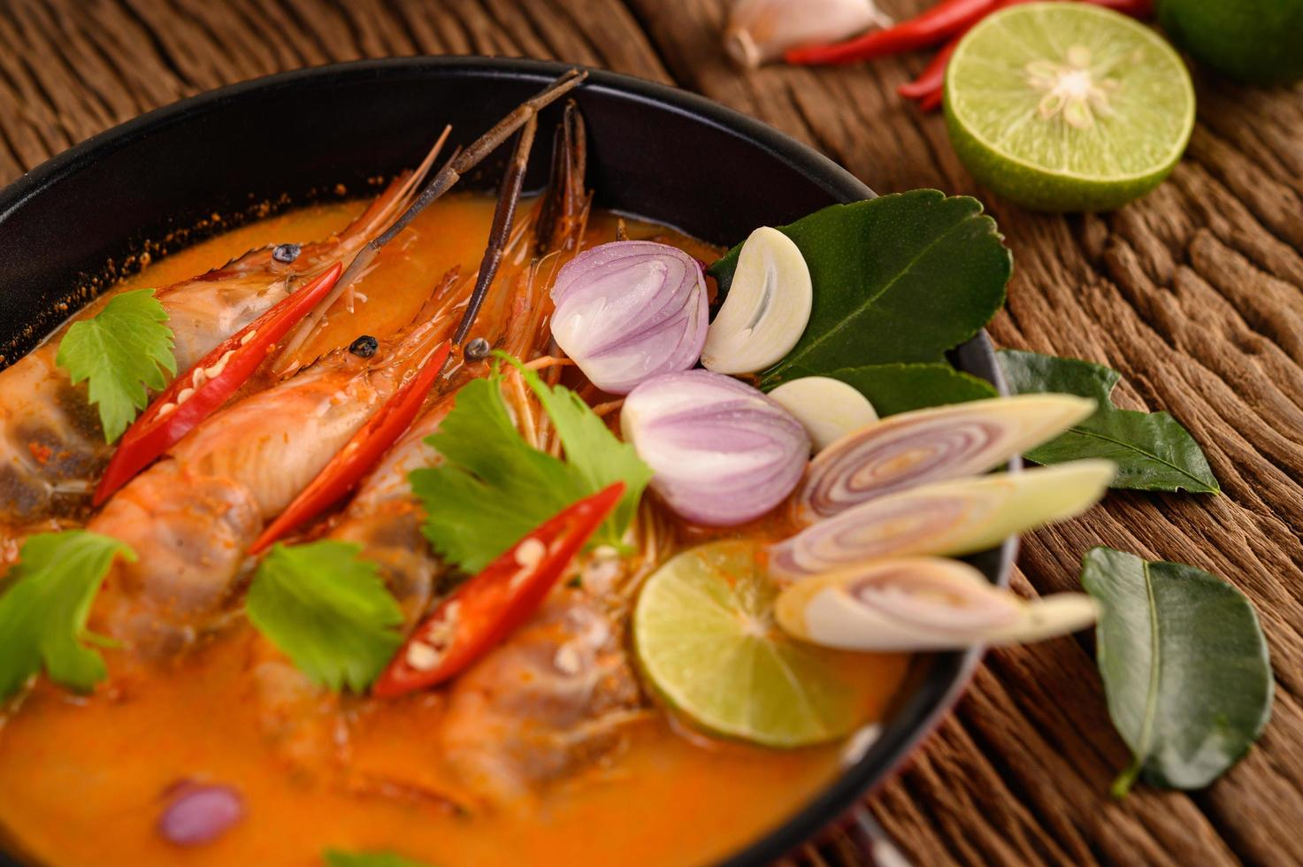 Thai hot spicy soup called tom yum kung with shrimp photo