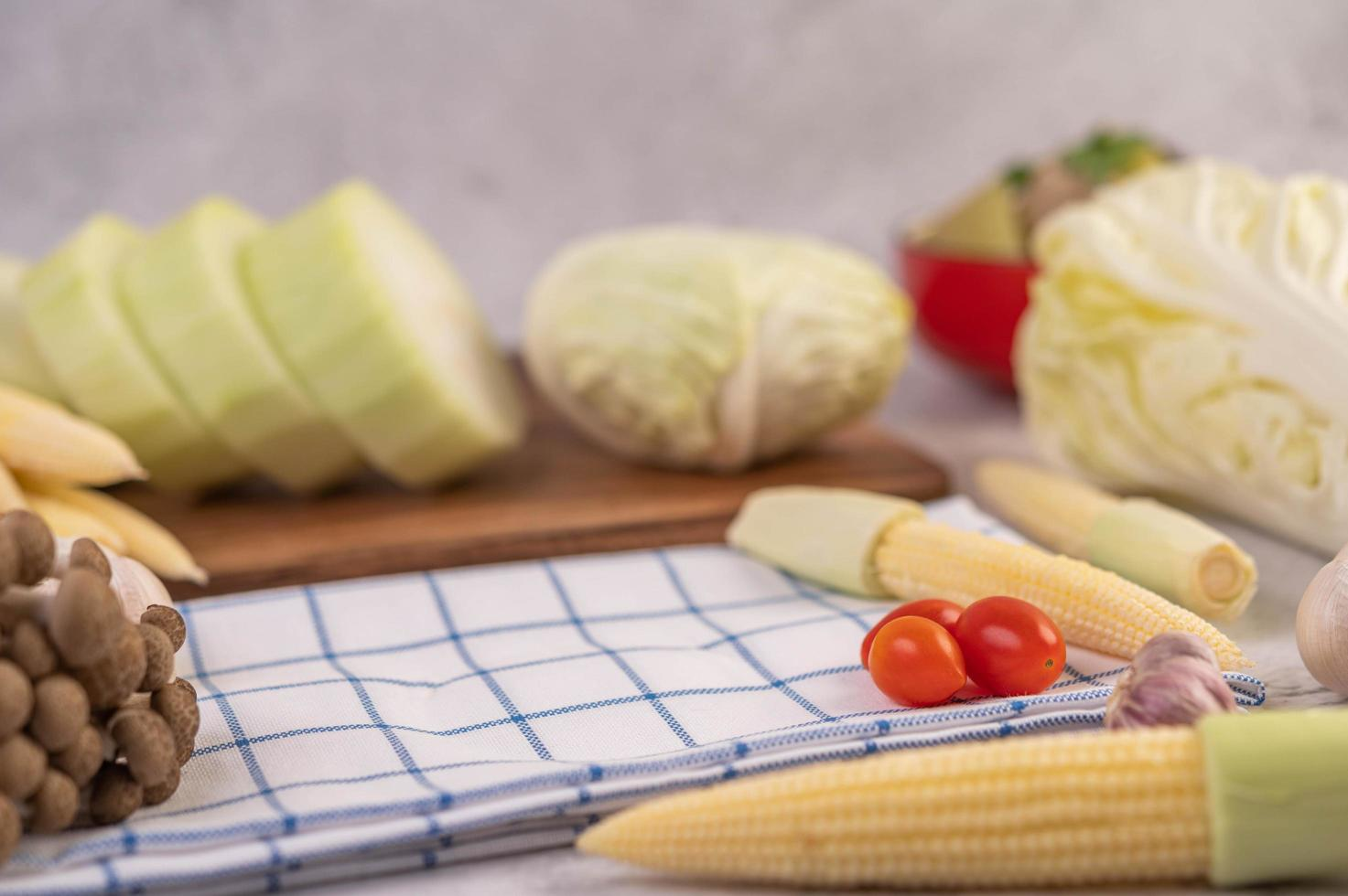 Baby corn, tomatoes, cabbage and mushrooms photo