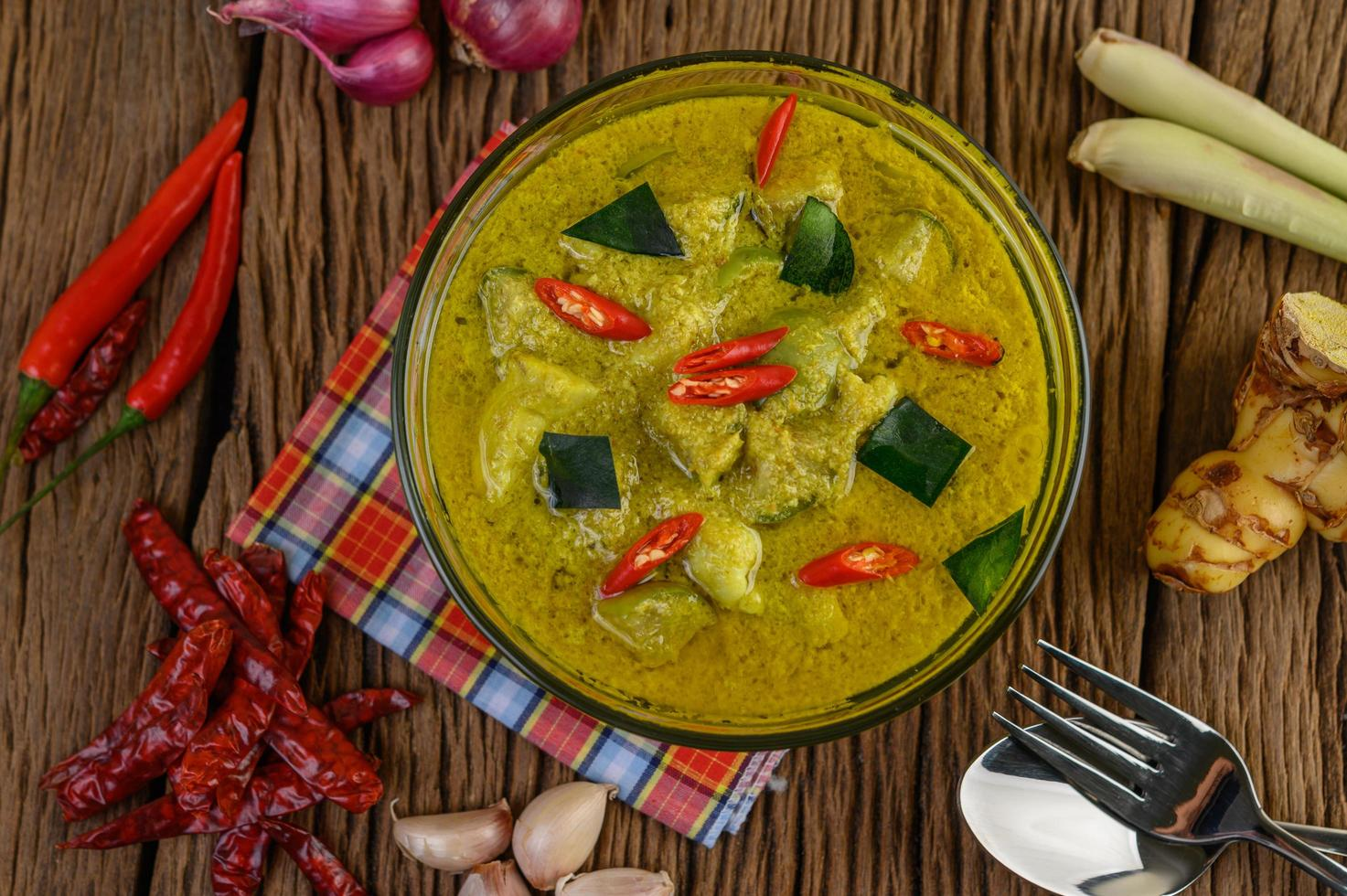 Green curry in a clear bowl photo