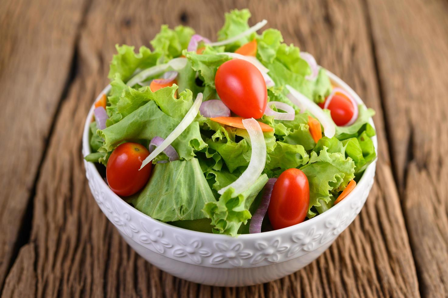 Salad on a wooden table photo