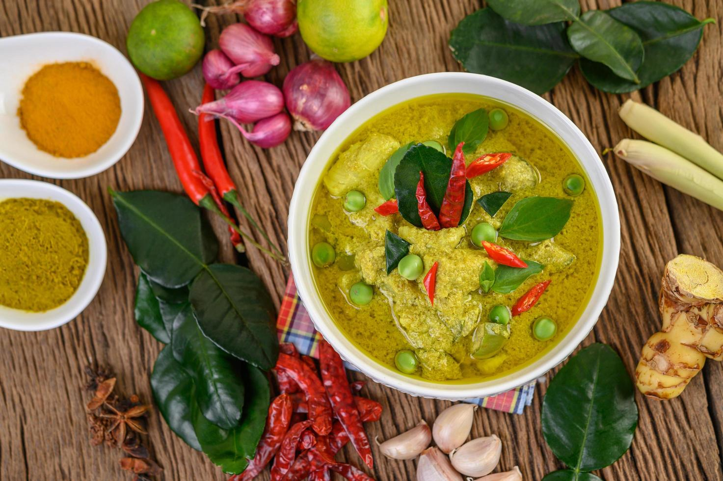 Spicy green curry in a bowl with spices photo