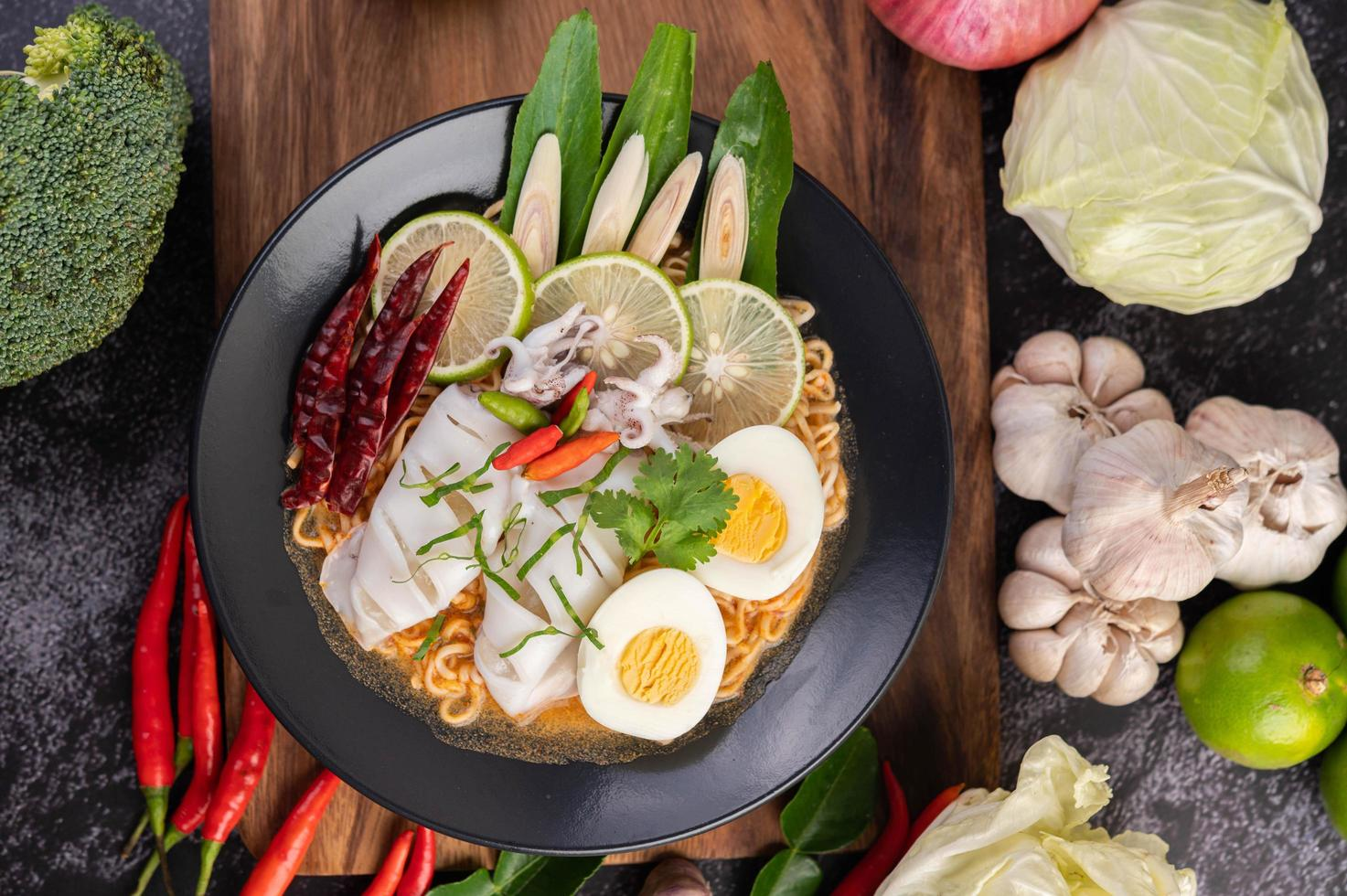 Noodles with squid and boiled egg photo