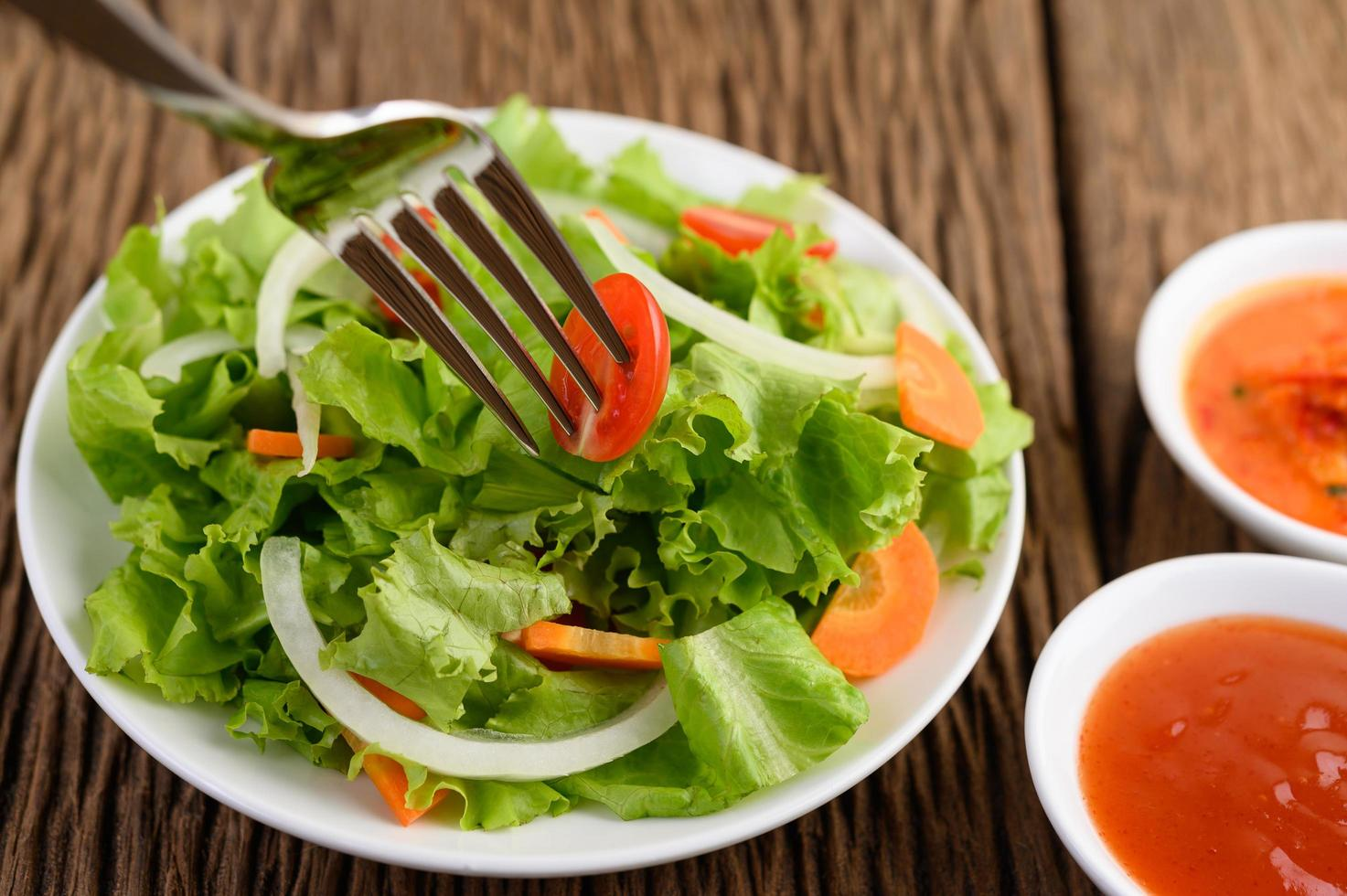 Fresh salad on a wooden table photo