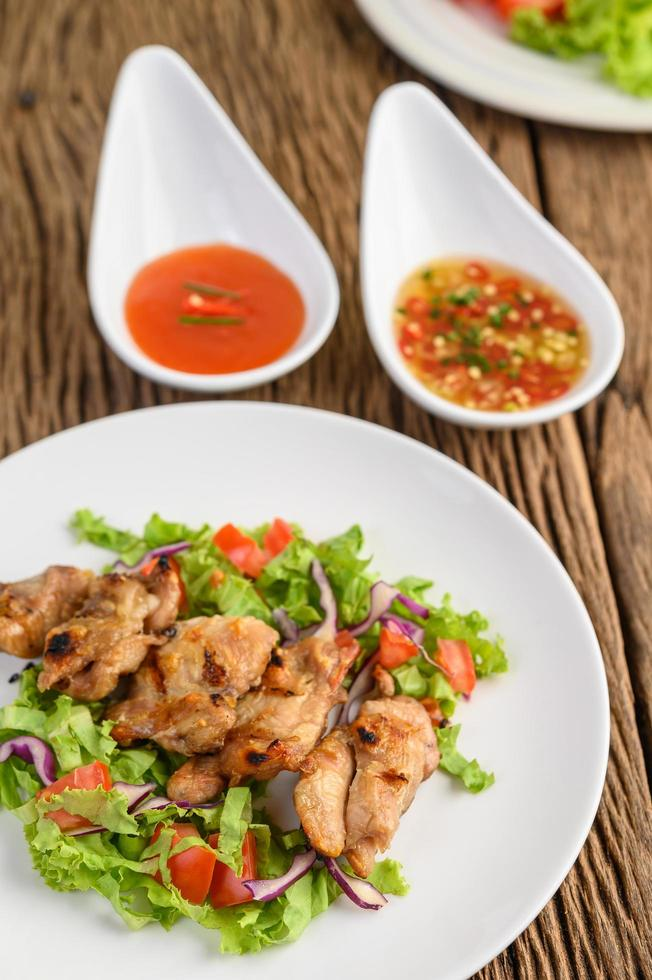 Grilled chicken with a salad photo