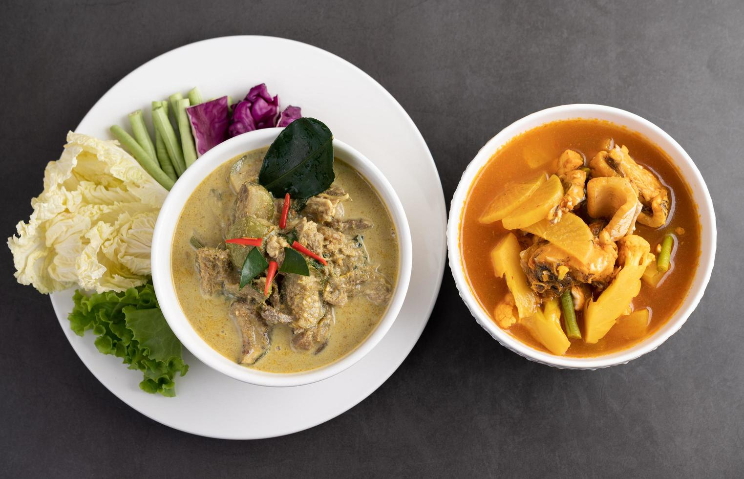Chicken green curry and snakehead fish curry photo