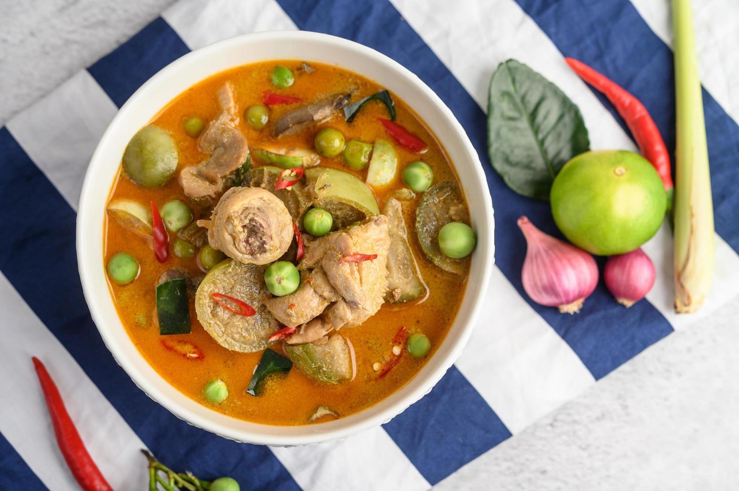 Spicy chicken stir-fried with Thai eggplant photo
