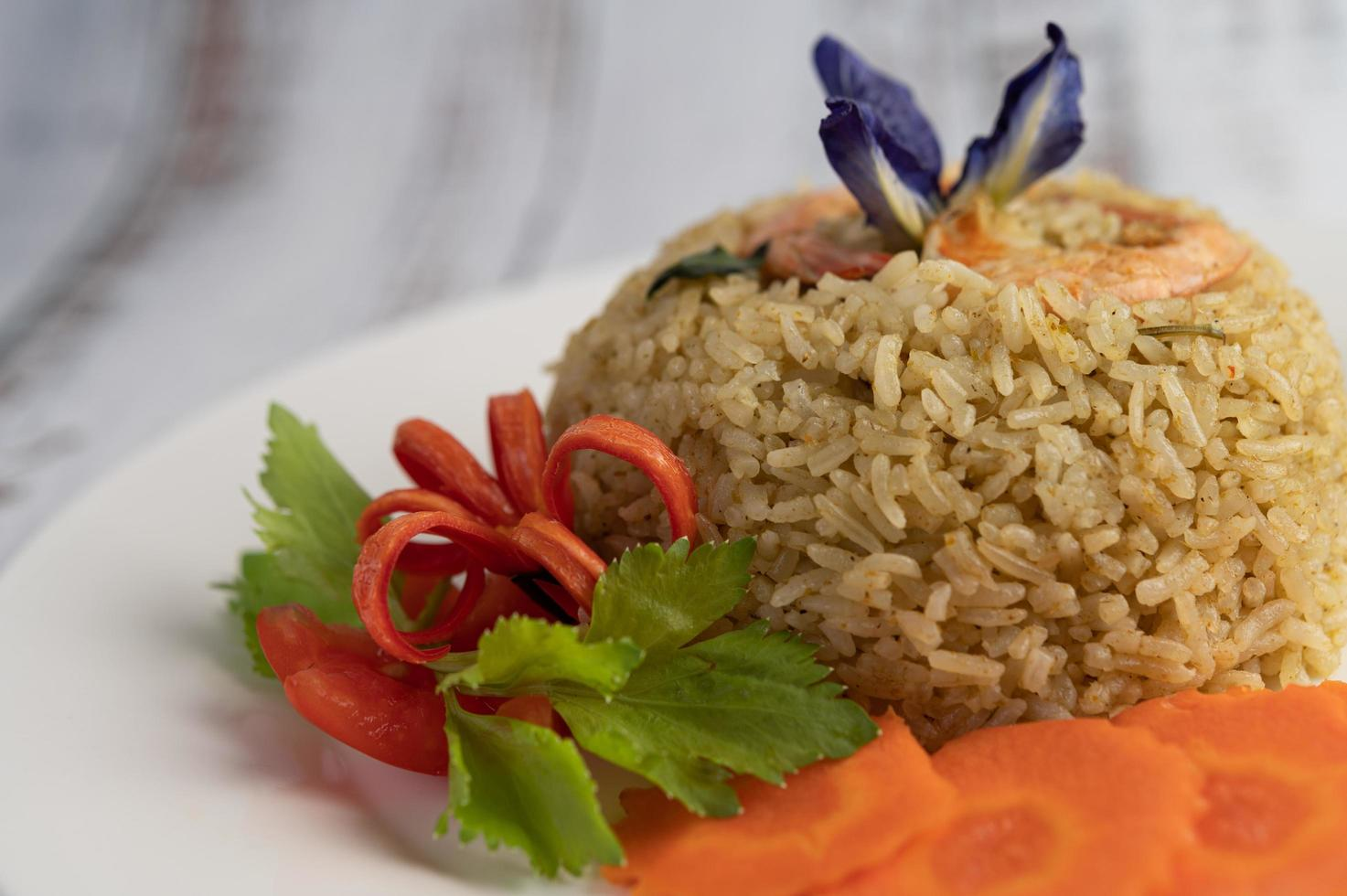 Shrimp rice with tomatoes and carrots photo