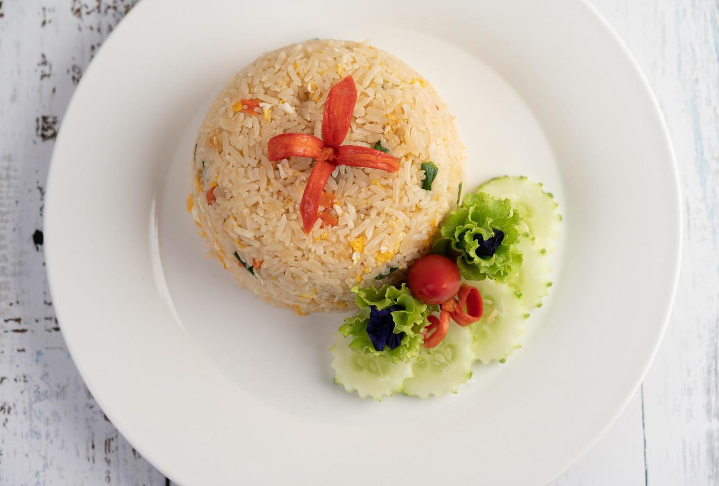 Fried rice with eggs on a wood background photo