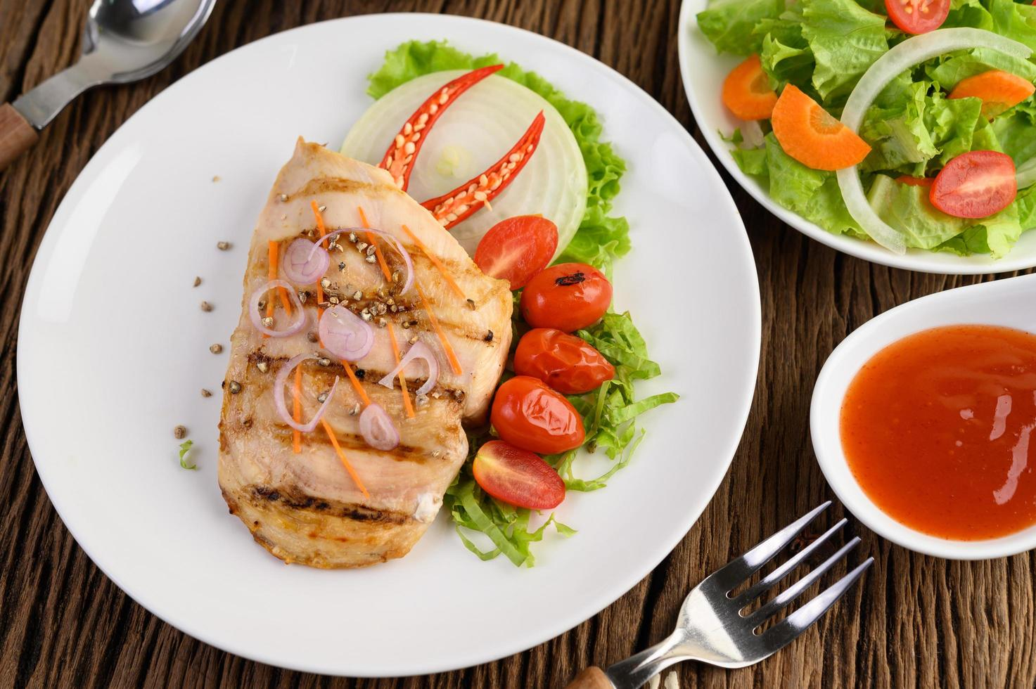 Grilled chicken with grilled vegetables and salad photo