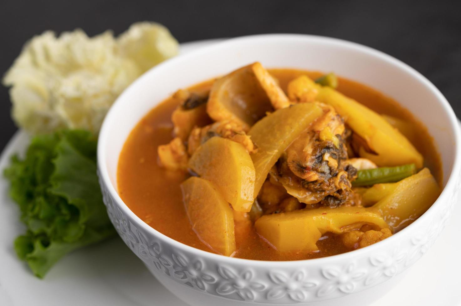 Yellow curry with snakehead fish photo