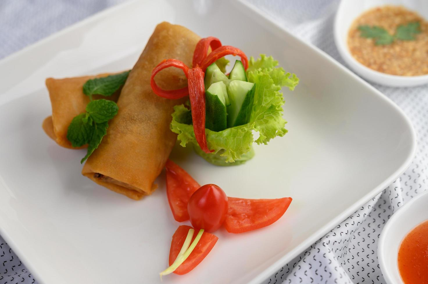 Fried egg roll with salad photo