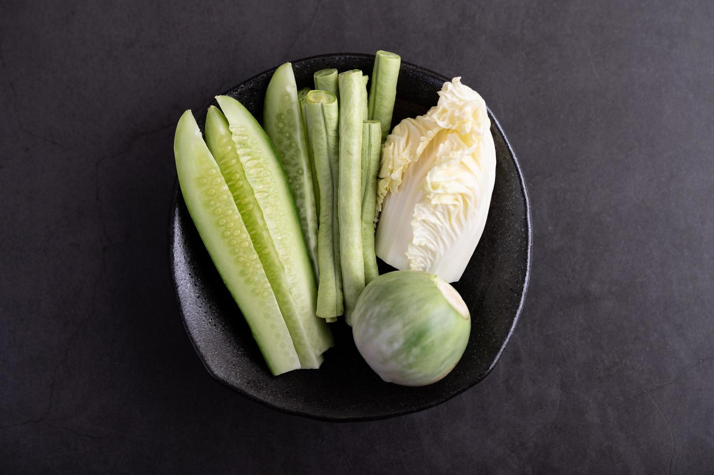 Cucumber, yard long beans, Thai eggplant and white cabbage photo