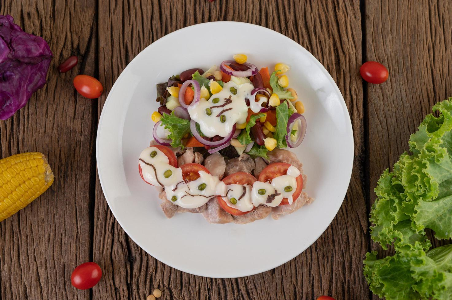 Fruit and vegetable salad on a white plate photo