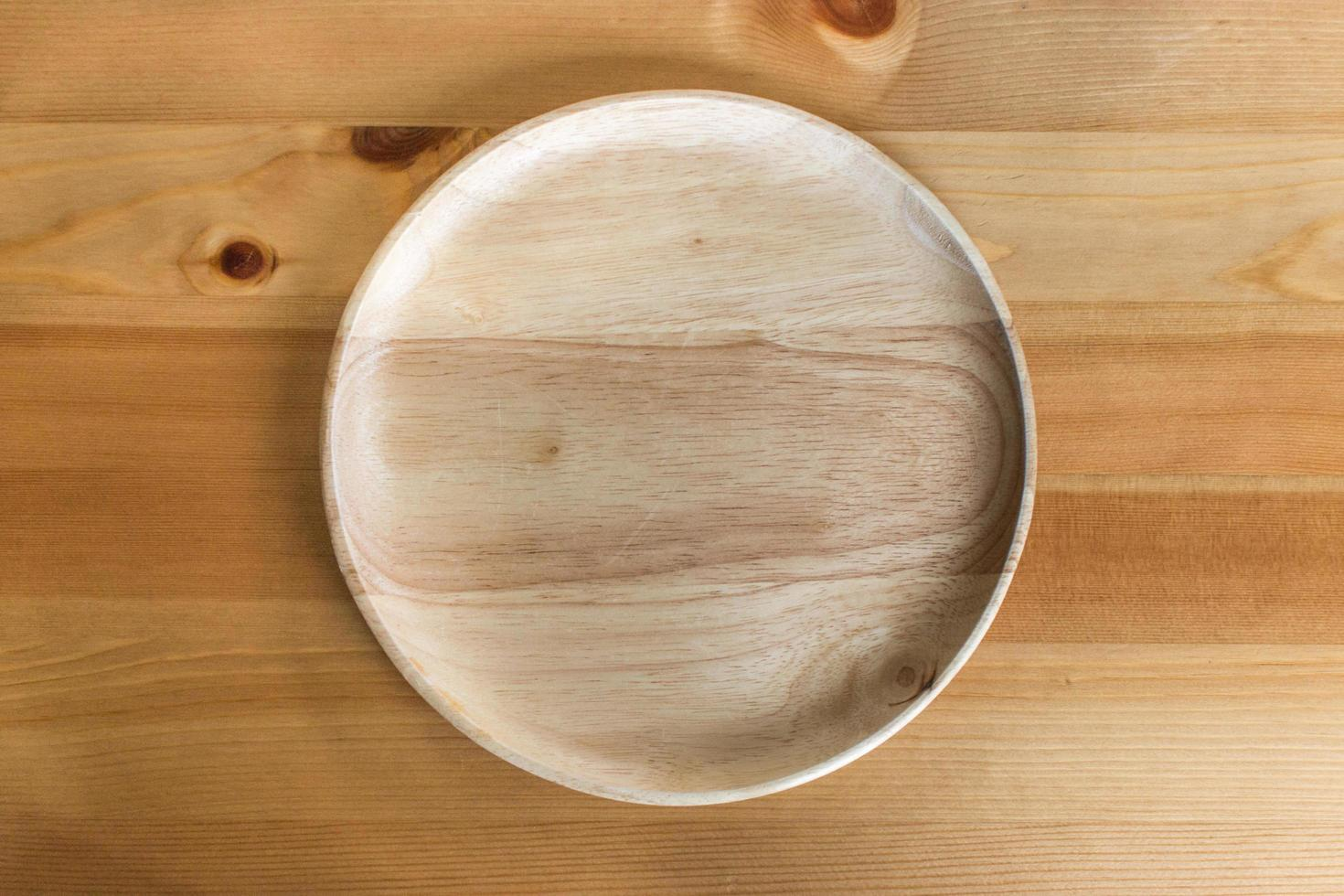 Wooden Plate On Wood Table Stock Photo