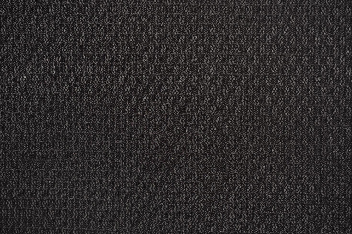 Fondo texturizado de tela de nailon negro con forma hexagonal foto