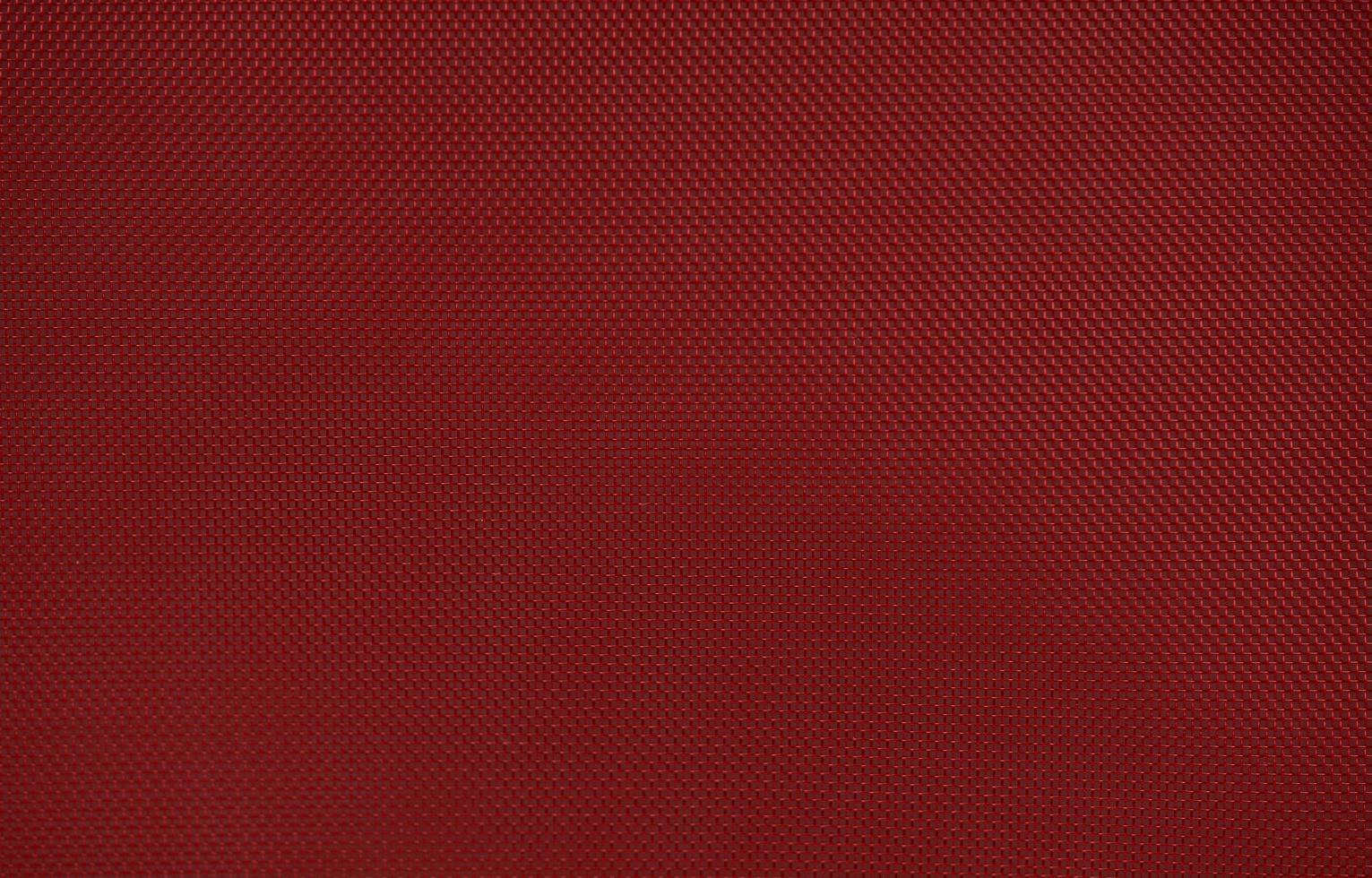 Fondo de textura de tela de nailon rojo con forma hexagonal foto