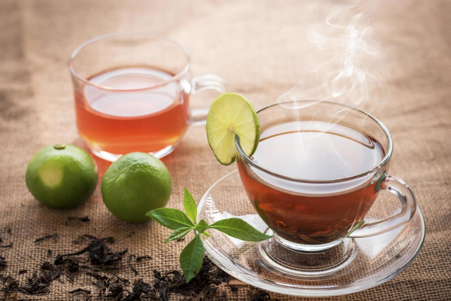 Hot tea of cup with slice of lemon photo