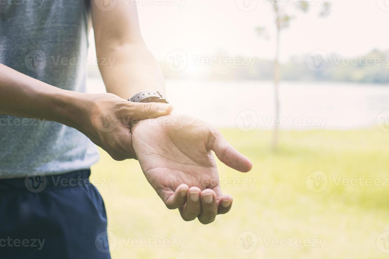 Person holding injured wrist photo
