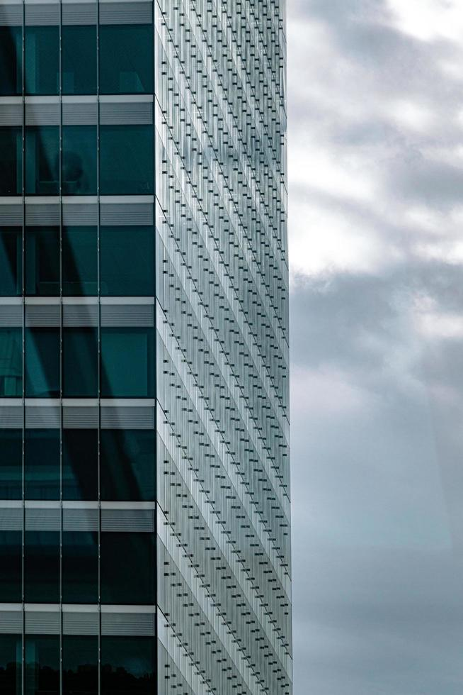 Gray and white concrete building under gray clouds photo