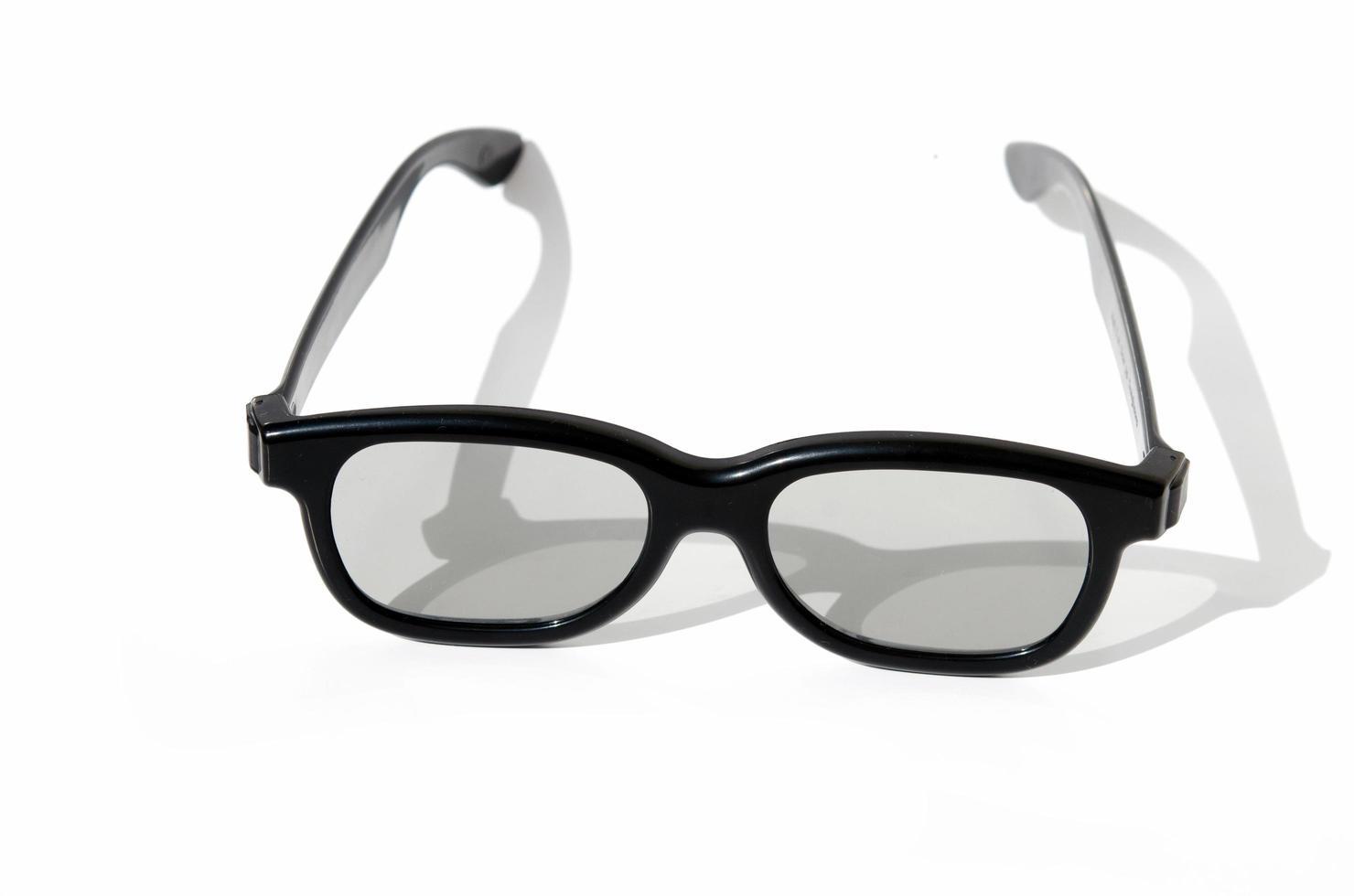 Black glasses on white background photo