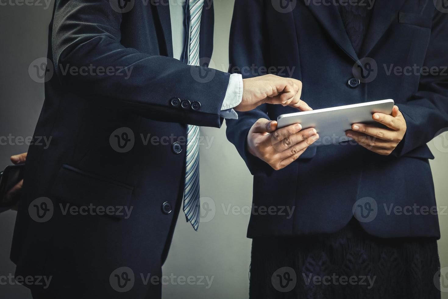 Two business people looking at a tablet photo