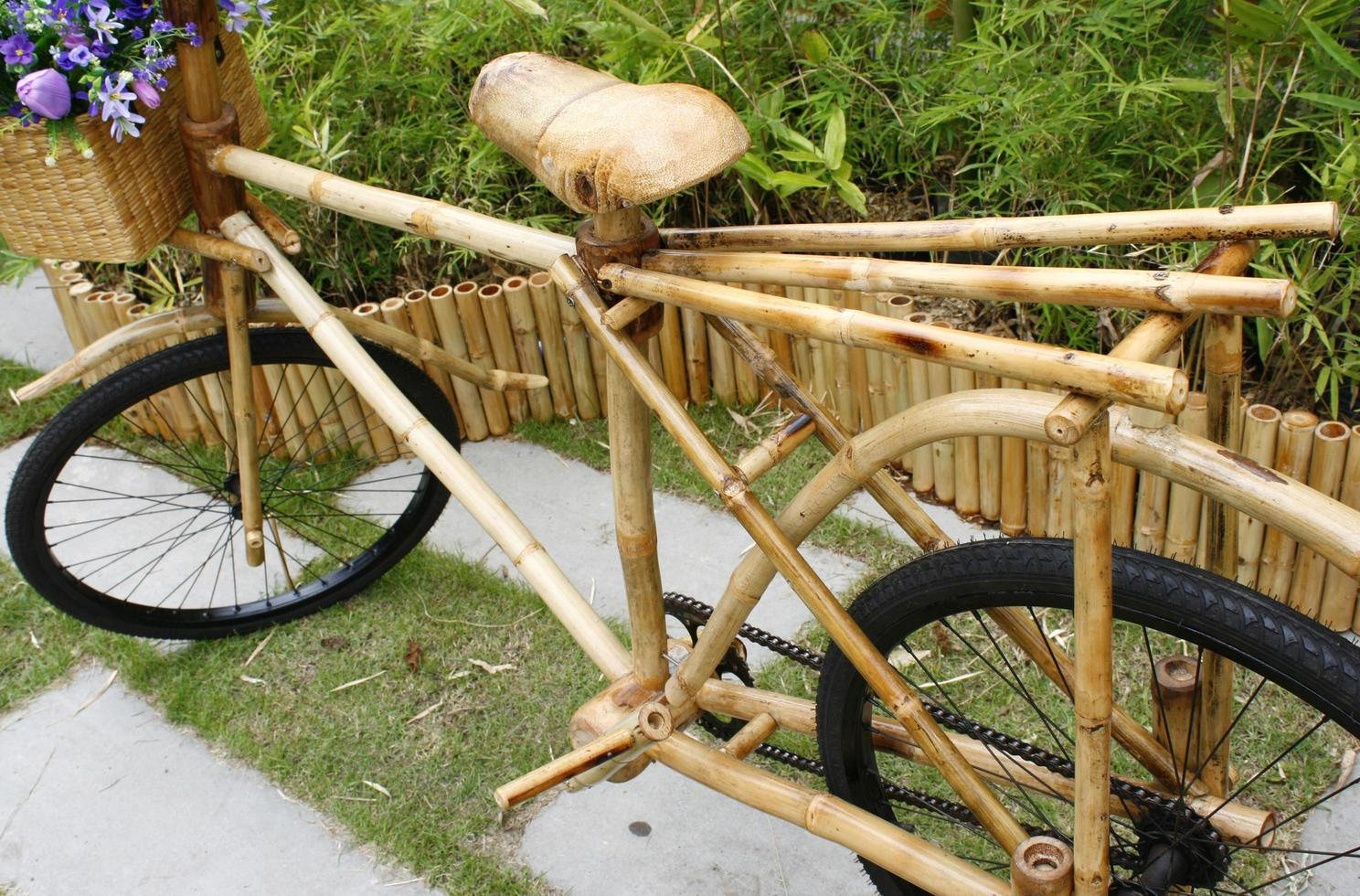 bamboo bicycle with bouquet photo