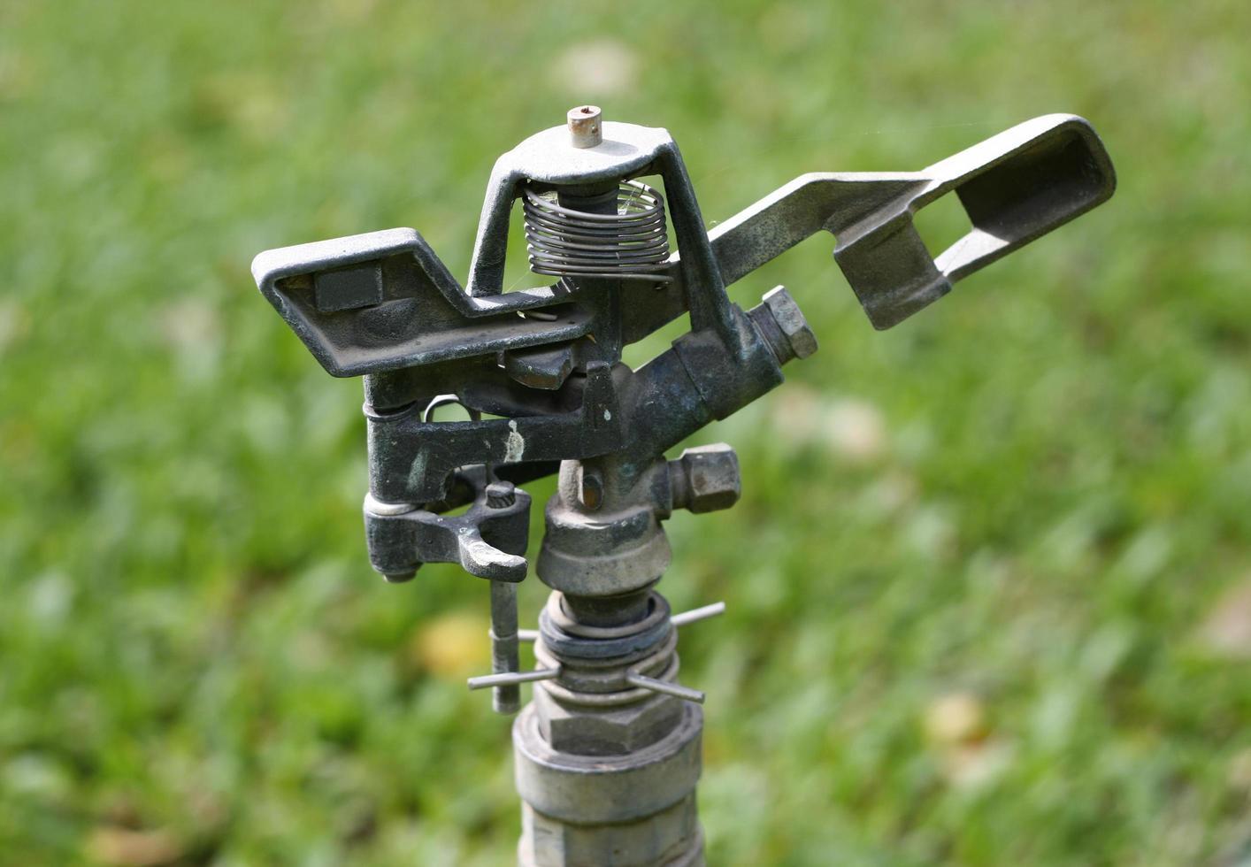 water springer on ground in garden photo