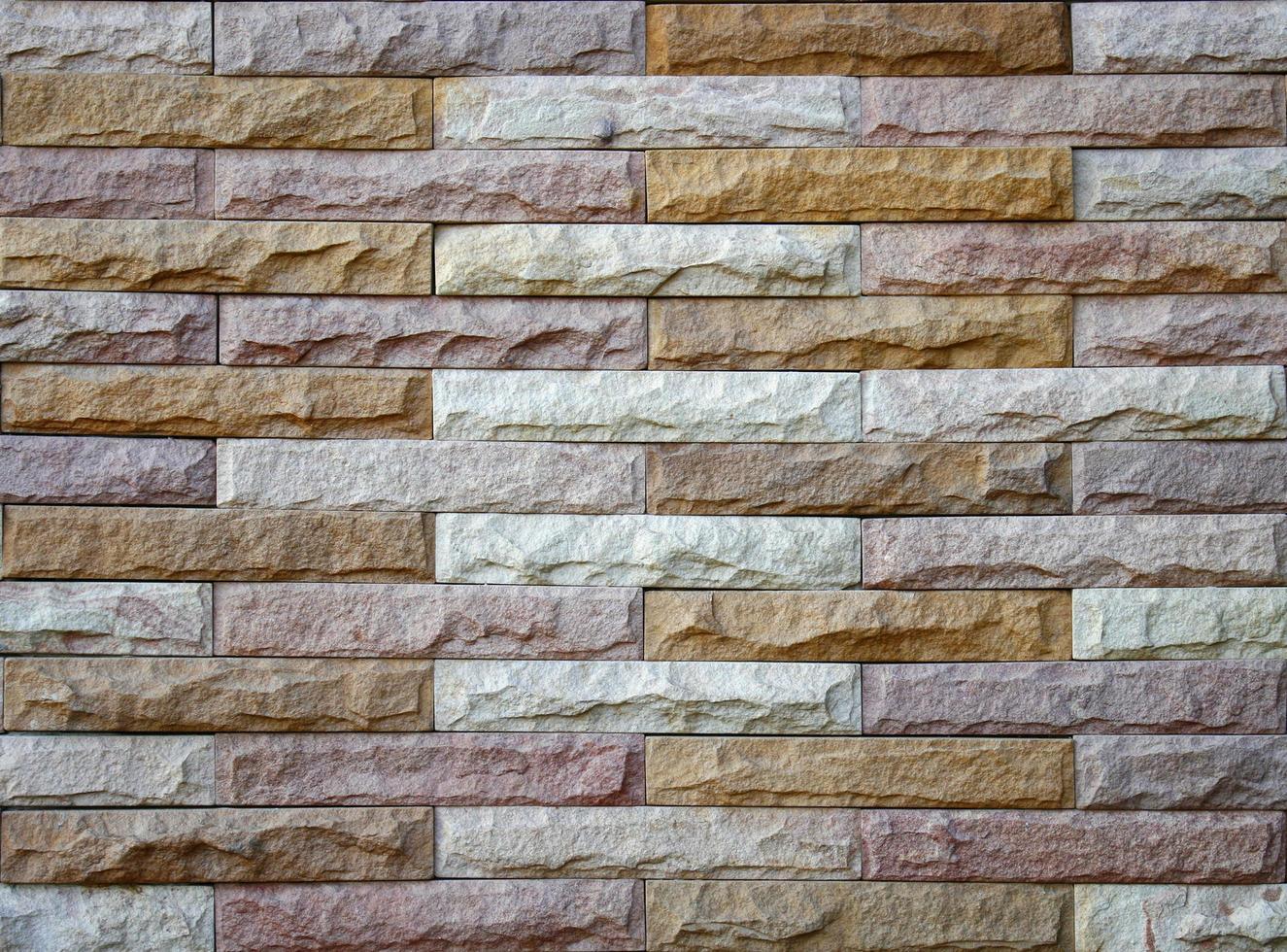 Fondo de muro de piedra hecho con bloques foto