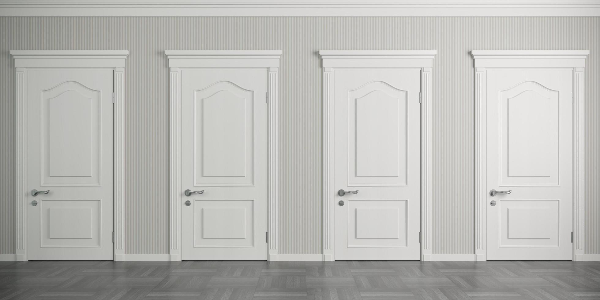 Four white classic doors on the wall photo