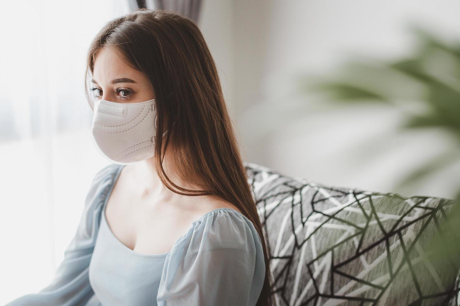 Woman wearing face mask photo