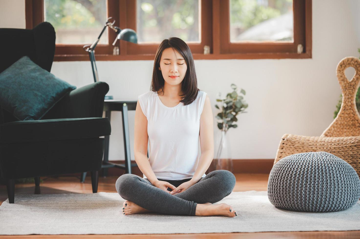 Woman practicing meditation photo