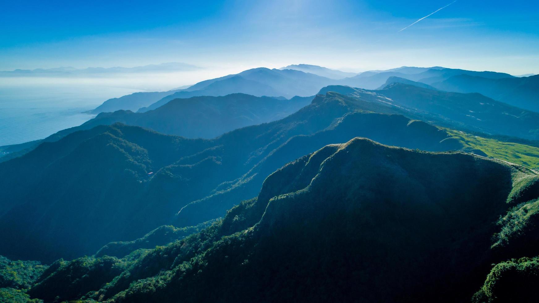 Foggy mountains and a blue sky photo