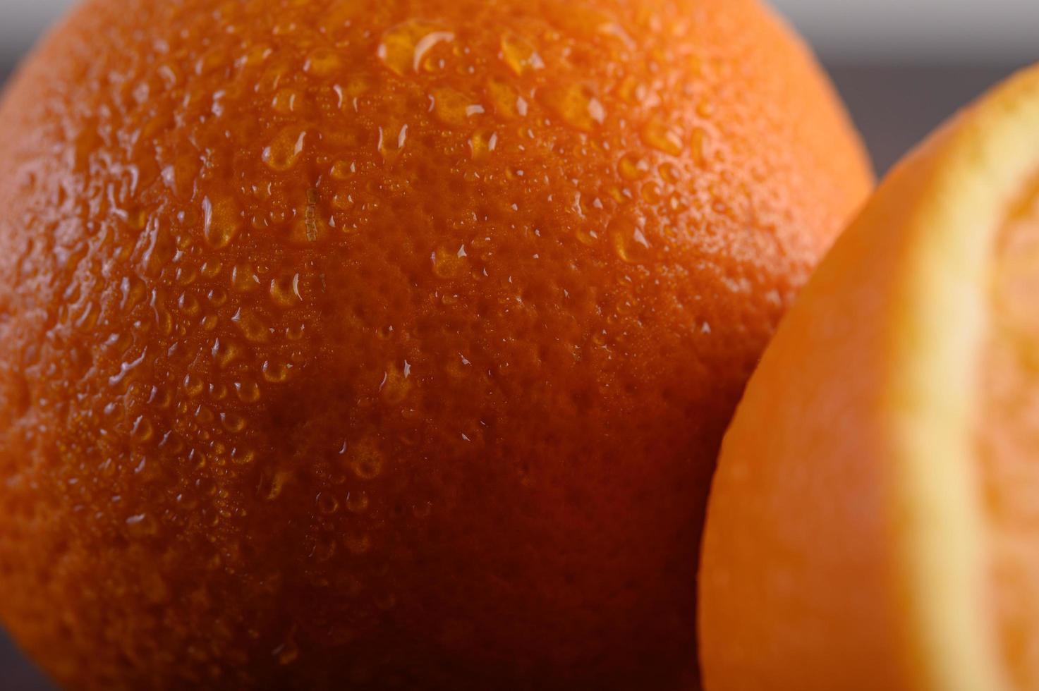 Macro image of ripe orange with small depth of field photo