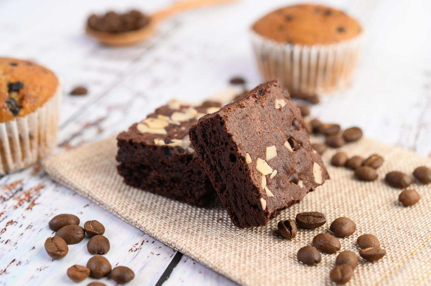 Chocolate brownies on a sackcloth with coffee beans photo