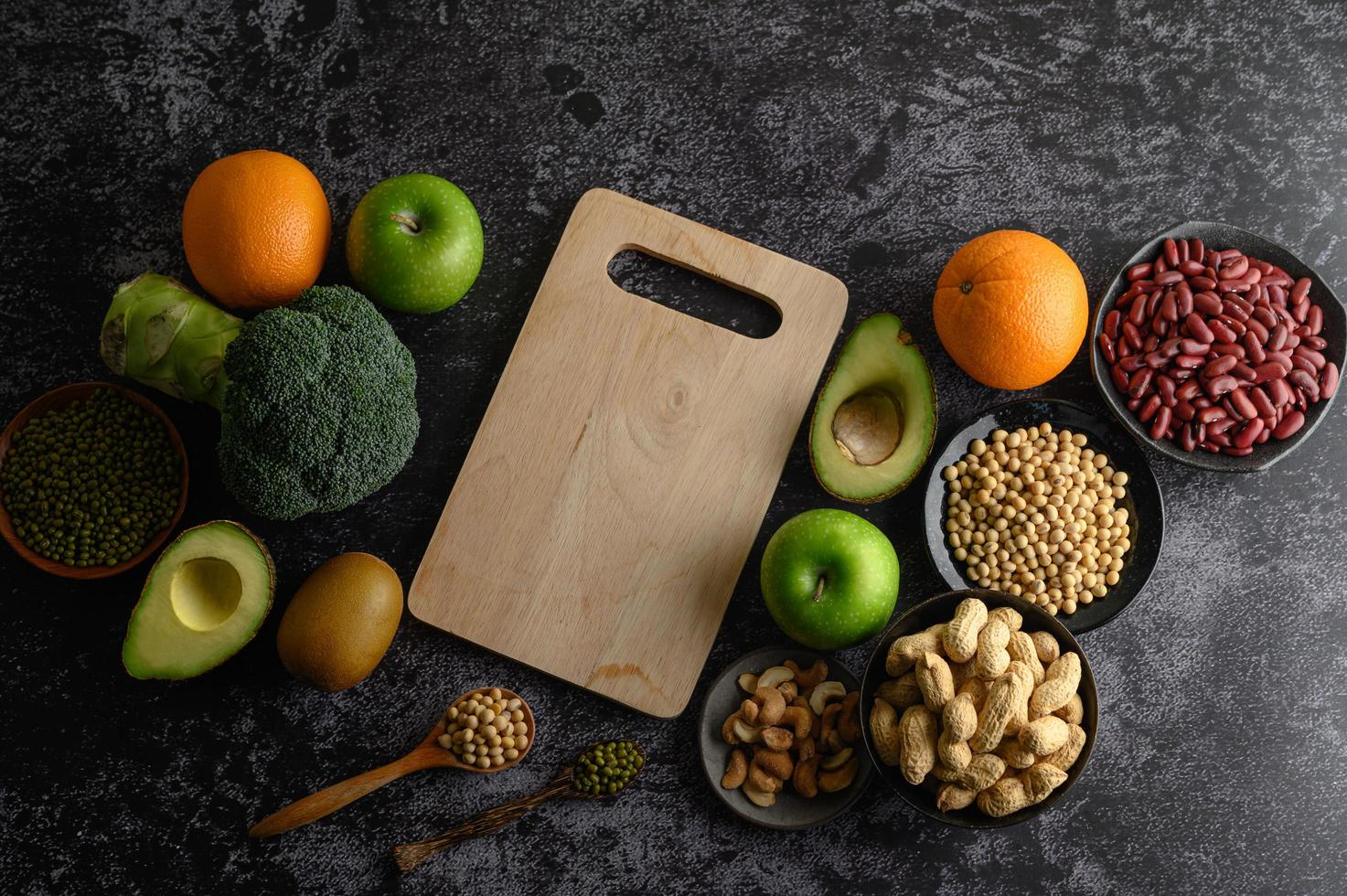 Legumes and fruit on a dark background photo