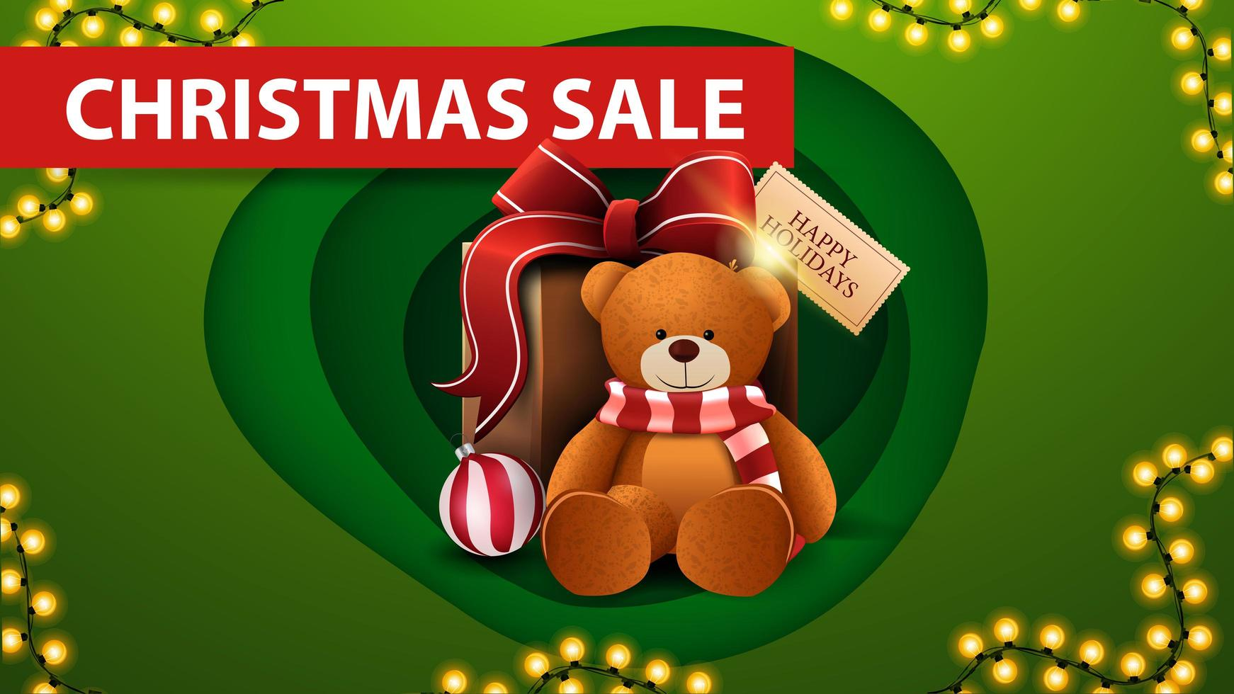 Christmas sale, green discount banner in paper cut style, garland and present with Teddy bear vector