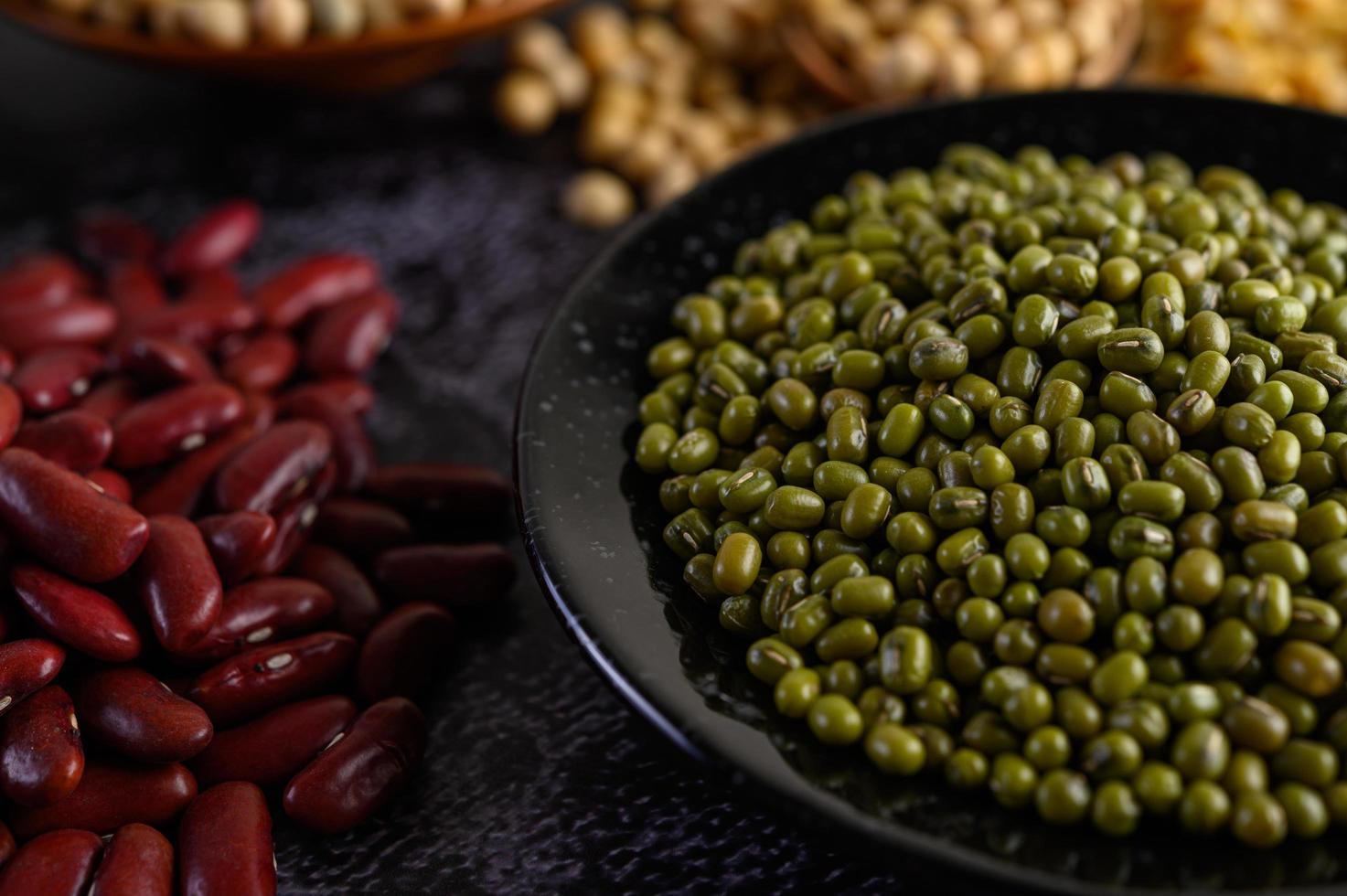 Mung bean and red bean on a black cement floor background photo