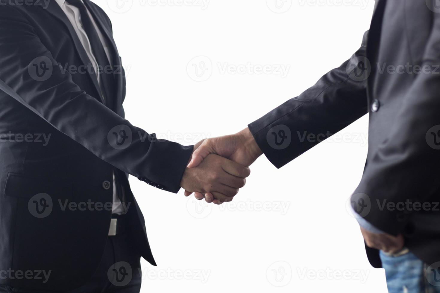 Two business men shaking hands photo