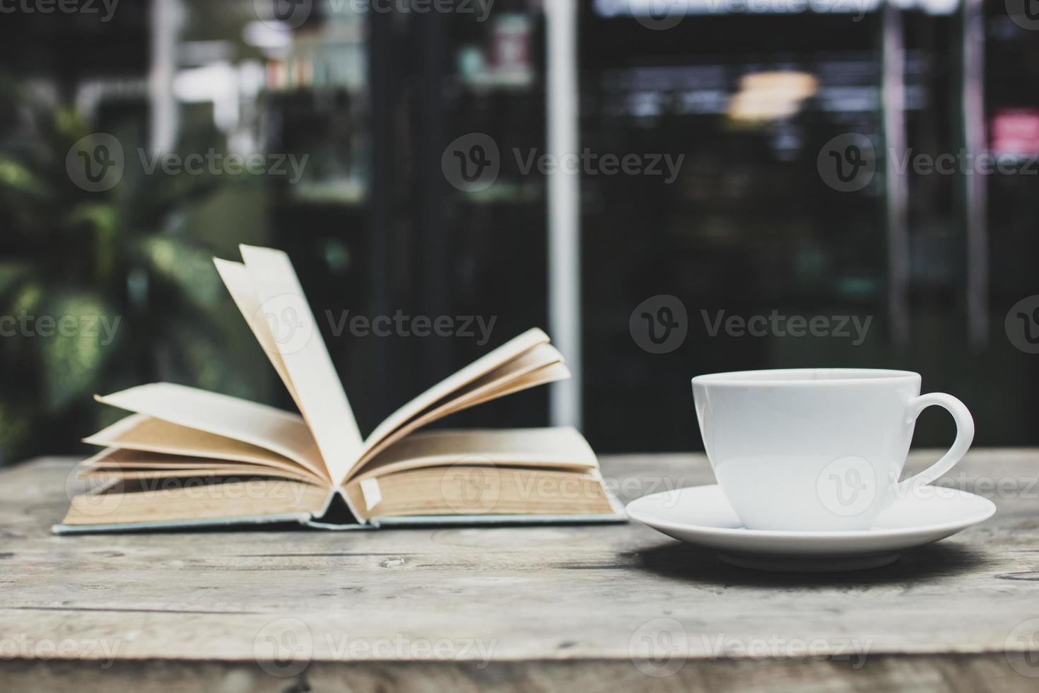 Coffee mug and an open book photo