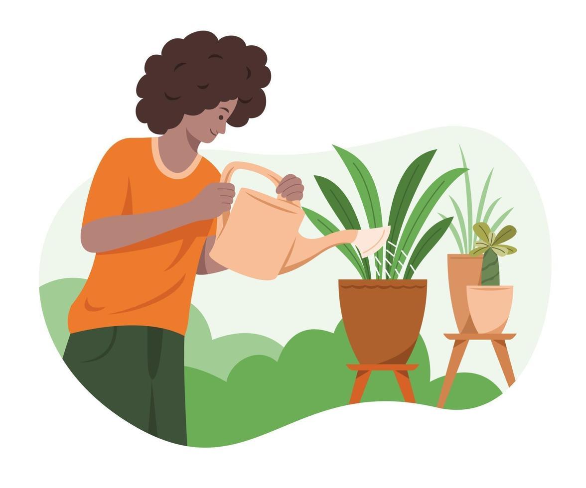 el hombre está regando las plantas en el jardín. vector