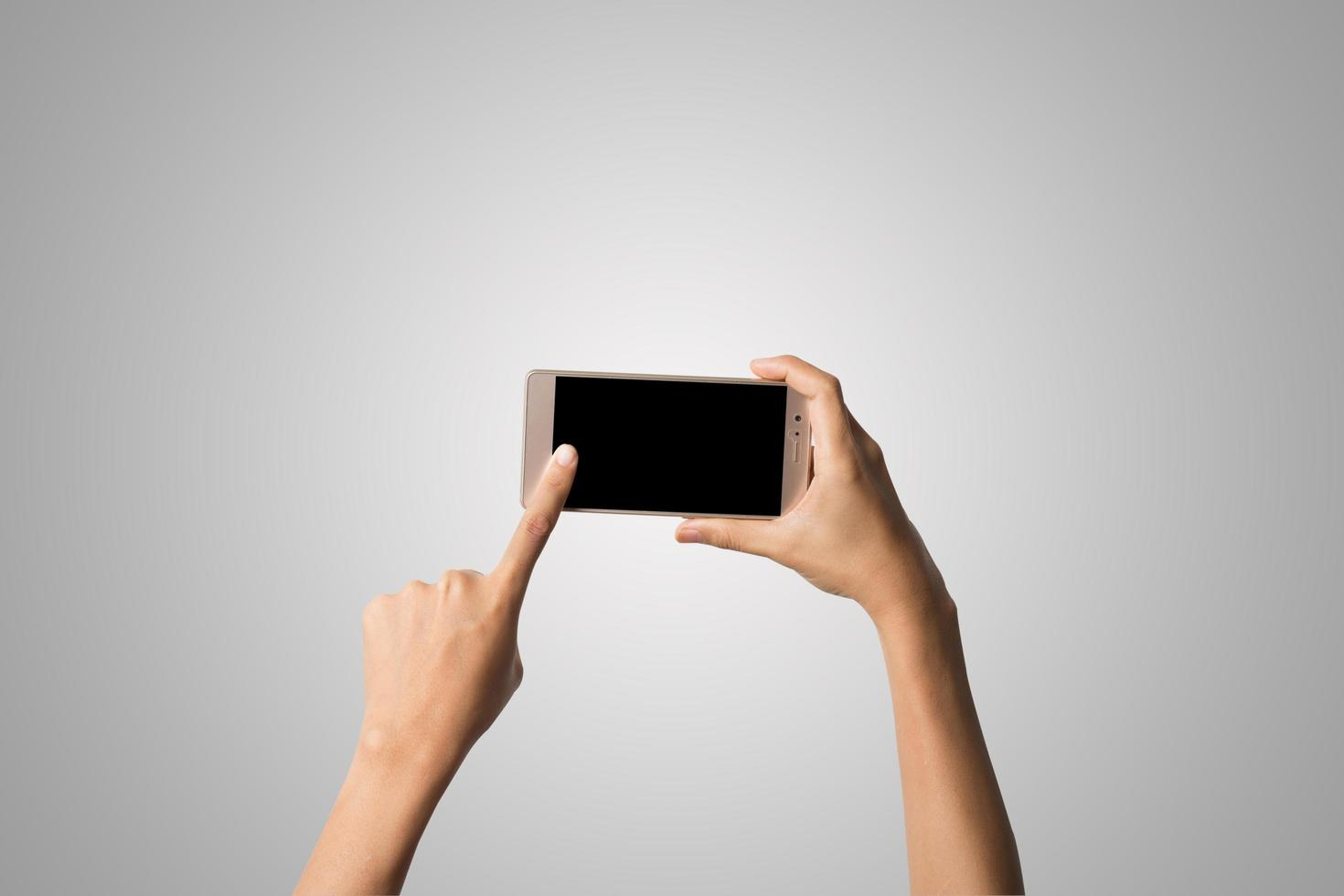 Close-up of a woman's hand holding a phone isolated on white background photo